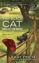 The Black Cat Knocks on Wood af Kay Finch