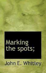 Marking the Spots; af John E. Whitley