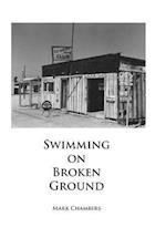 Swimming on Broken Ground af Mark Chambers