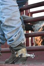 A Cowboy Boots and Spurs at a Rodeo Journal