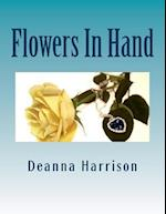 Flowers in Hand af Deanna L. Harrison