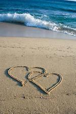Two Loving Hearts Drawn in the Sand at the Seashore Journal