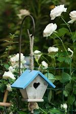 White Flowers and a Birdhouse with a Blue Roof Journal