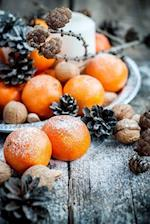 A Winter Centerpiece with Tangerines, Walnuts, and Pinecones Journal