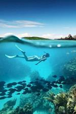 Woman Snorkeling by a Coral Reef in the Ocean Journal