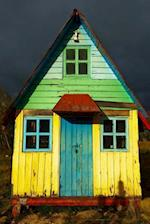 A Colorful Rustic House and Dark Storm Clouds Journal