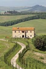 View of a Picturesque Stone Farmhouse in Tuscany Italy