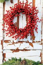 Winter Wreath with Red Holly Berries on a Vintage Wooden Door Journal