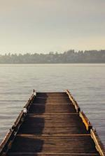 A Weathered Wooden Dock Leading to a Misty Lake Journal