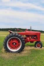 A Bright Red Tractor on a Farm in Delaware USA Journal
