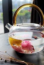 Blooming Herbal Tea in a Glass Teapot Relaxation Journal