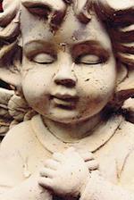 A Sweet Baby Angel Sculpture Up Close Portrait Journal