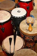 Vintage Drums and a Maraca Percussion Musical Instruments Journal