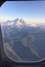 Looking Out an Airplane Window at a Snow Covered Mountain Travel Journal