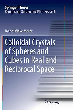 Colloidal Crystals of Spheres and Cubes in Real and Reciprocal Space