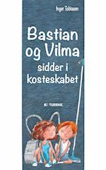 Bastian og Vilma sidder i kosteskabet