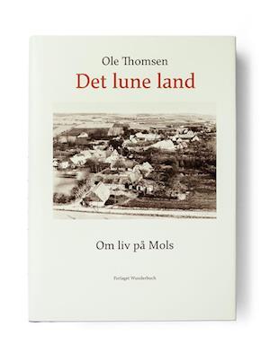 Bog, lærredsindbundet Det lune land af Ole Thomsen